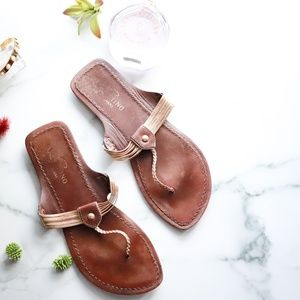 VALENTINO leather flipflop sandals gold brown